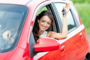 Woman Waving in Car
