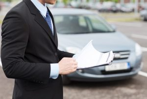 Man in Suite with Car