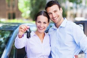 Couple Holding Keys