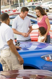 Family Looking at Car