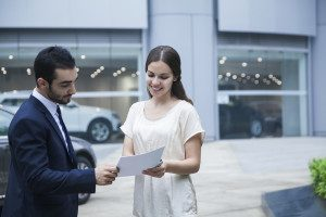 Woman talking to Dealership