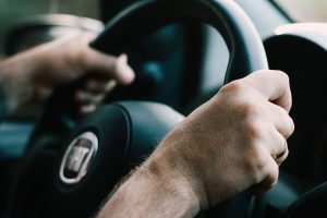 Holding steering wheel of car